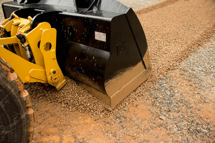 Performance Series flat-floor buckets for Cat small wheel loaders yield superior results in light-grading and back-dragging applications
