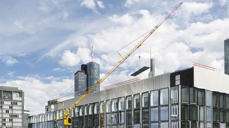 Wiesbauer's Liebherr MK 140 mobile construction crane working in Frankfurt's banking area