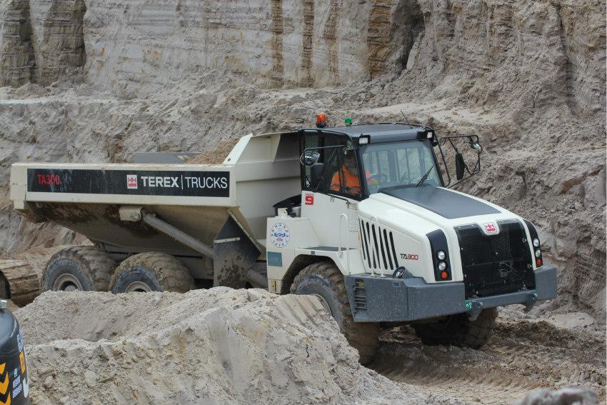 Fifteen Terex Trucks' TA300s articulated haulers shift sand in Dorset