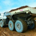 Hauling rock in Horokiwi with two TA400 articulated haulers